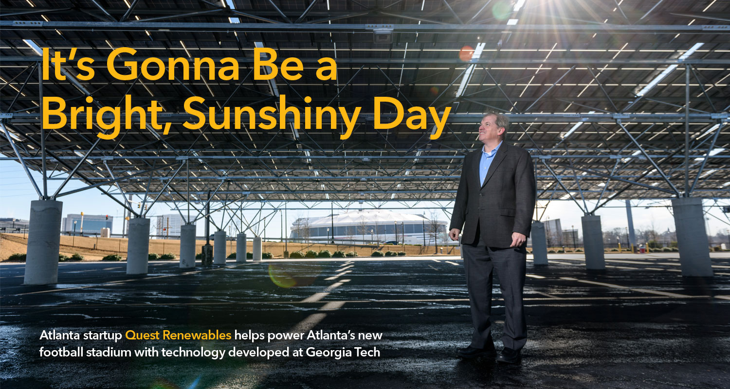 Norman Findley standing under a canopy of solar panels