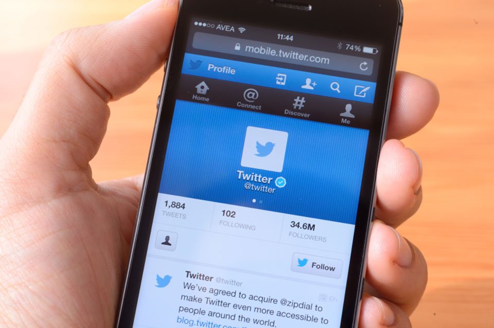 A mobile phone displaying Twitter