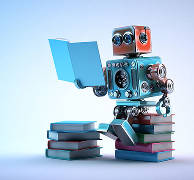 stock photo - toy robot reading book
