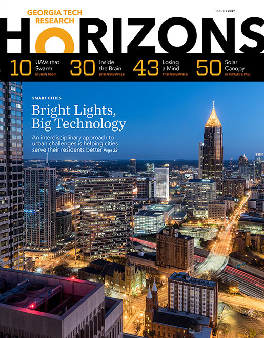 The cover of Research Horizons featuring a nighttime shot of Atlanta with bright moving lights