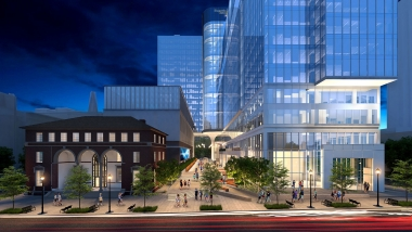 An architect's rendering of the Coda exterior at night showing a bright, lively street and plaza with many pedestrians