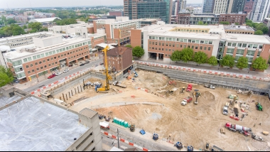An elevated image of Coda construction showing mostly dirt and equipment excavating the site
