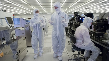 Researchers working in a clean room
