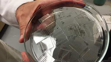 A clear substrate dish with samples of sol-gel material