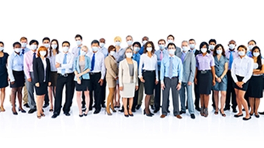 A large group of everyday people using surgical masks to block their noses and mouths