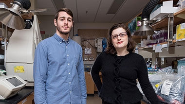 Portrait of two researchers standing side by side in a lab