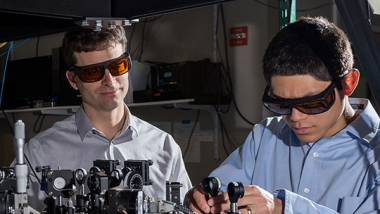 photo - research scientists Jason Amini and Nicholas Guise