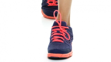 photo - woman's feet in running shoes