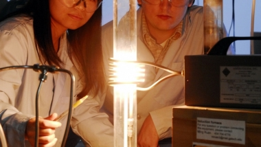 Researchers with graphene furnace
