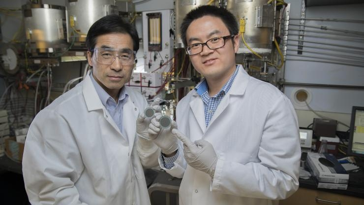 Meilin Liu and Yu Chen with catalyst-coated disc