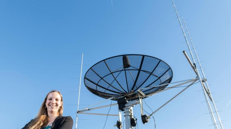 Mariel Borowitz with satellite communications equipment