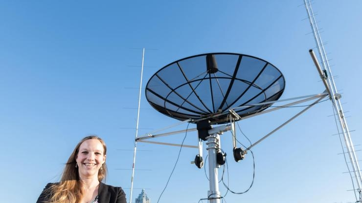 Mariel Borowitz with satellite communications equipment (2)