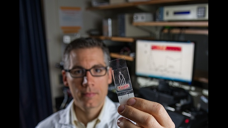 Craig Forest with microfluidic chip