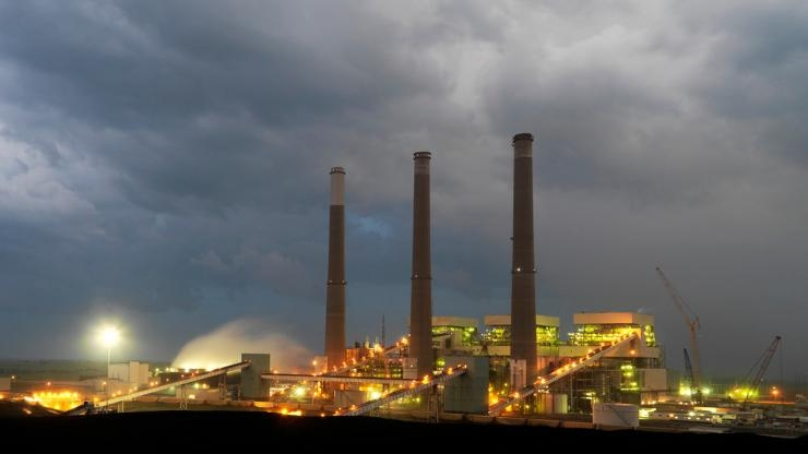 Coal-fired power plant by night