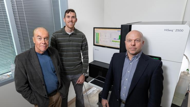 Researchers with Sequencing Equipment