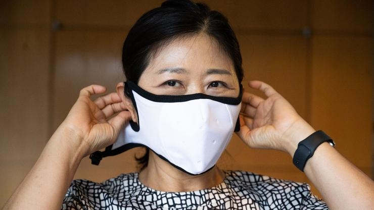 Sungmee Park Puts on Face Mask