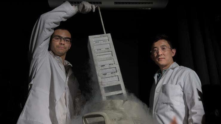 Gabe Kwong (r.) with vat that stores T cells in his lab at Georgia Tech