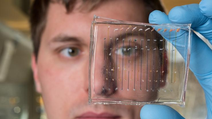 James Dahlman with microfluidic chip