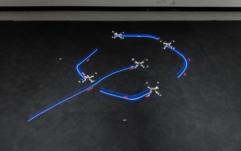 photo - time lapse image of small robots in motion on floor