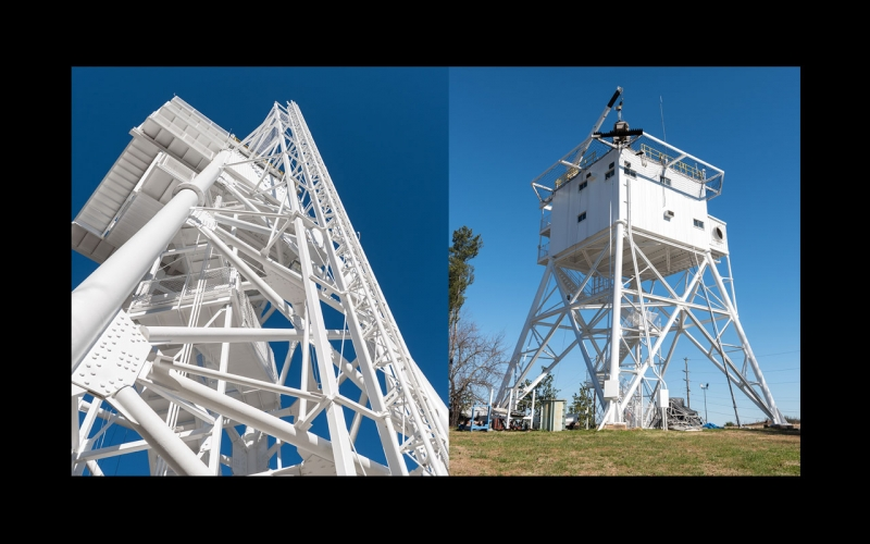 Photo of two multistory signal towers at the GTRI far-field antenna test range